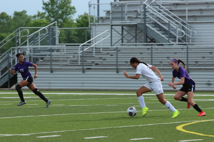 Making a move on a defender, senior Autumn Halliwell breaks away towards the goal before scoring.