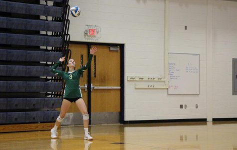 """Sophomore Katrina Walbridge serves the ball at the Bulldogs. She's the libero for the JV Rats.  """"I like playing volleyball because it helps me de-stress and I love my team. Tournaments are always fun because we get to spend the whole day together."""""""