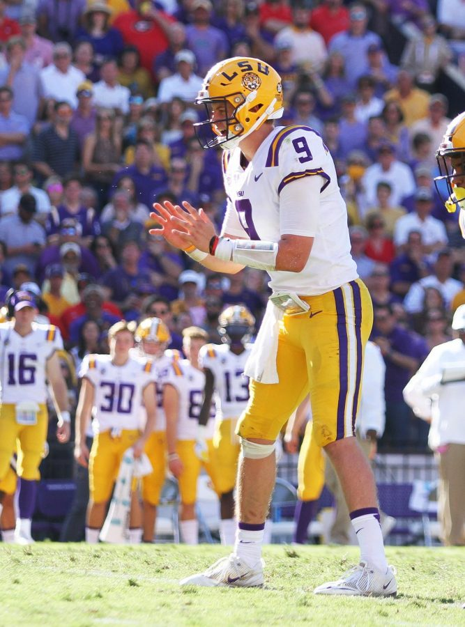 Joe Burrow pictured taking a snap against the Georgia Bulldogs.