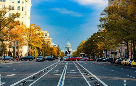 A shot of the United States Capitol building from the busy streets of Washington D.C.