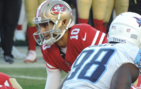 49ers Quarterback Jimmy Garoppolo lines up under center to take the snap.