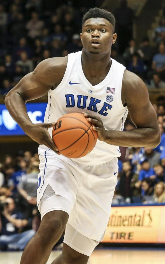 Zion+Williamson+looks+to+pass+in+a+Duke+exhibition+game.+Prominent+players+like+him+will+be+able+to+secure+endorsements+in+college.+