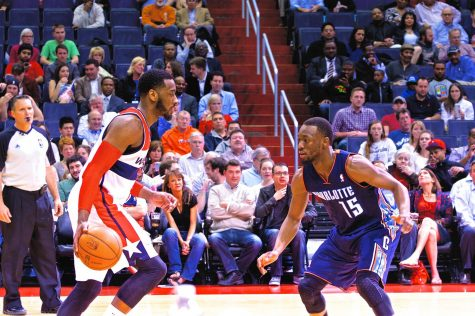 John Wall taking on Kemba Walker. From Wikimedia creative commons.