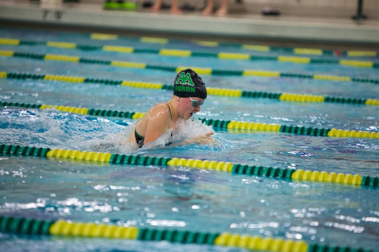 Junior Annaliese Streeter comes up for a breath before swimming back down.