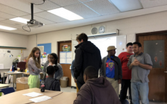 Students play name games, socialize during Unified cub meeting on Dec. 16.