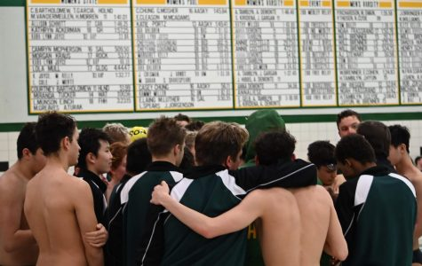 Senior Dylan Schmitzerle and Junior Eli Atkinson share a warm embrace during Huron's Tri-Meet against Lincoln and Adrian