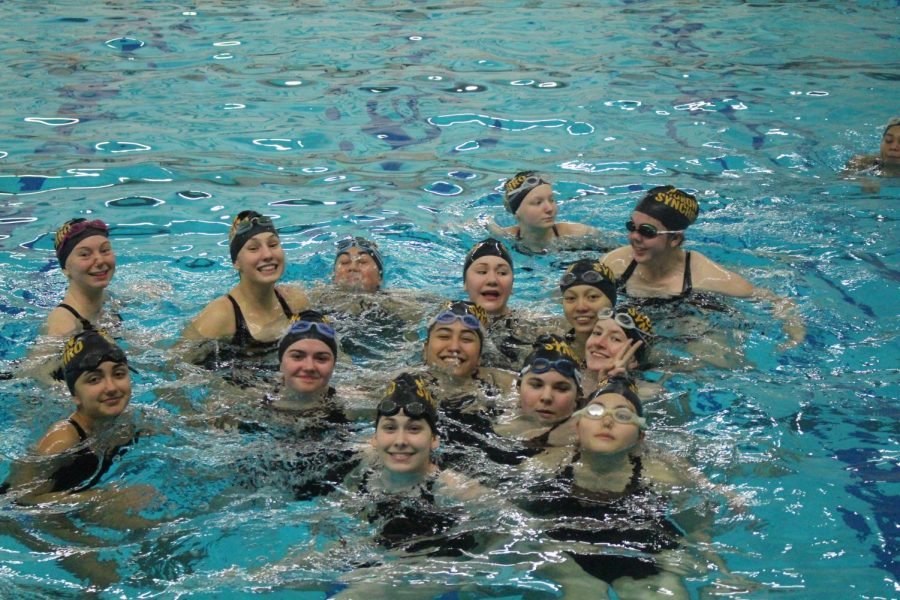 Huron's synchronized swimming team groups up to take a picture.