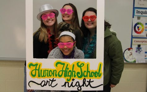 Juniors Kristin Thorsdottir, Abby Jelic, Payton Bristol and Elena Kaul dress up in costumes in Art Night's photo booth.