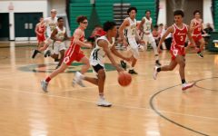 Junior Jake Watkins with his team against Monroe High school.