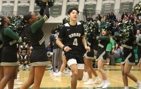 Junior Tyson Edmonson jogs onto the court prior to the Huron vs. Pioneer showdown