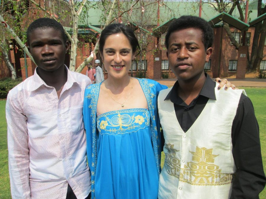 Claire Federhofer(center) with two of her previous students.