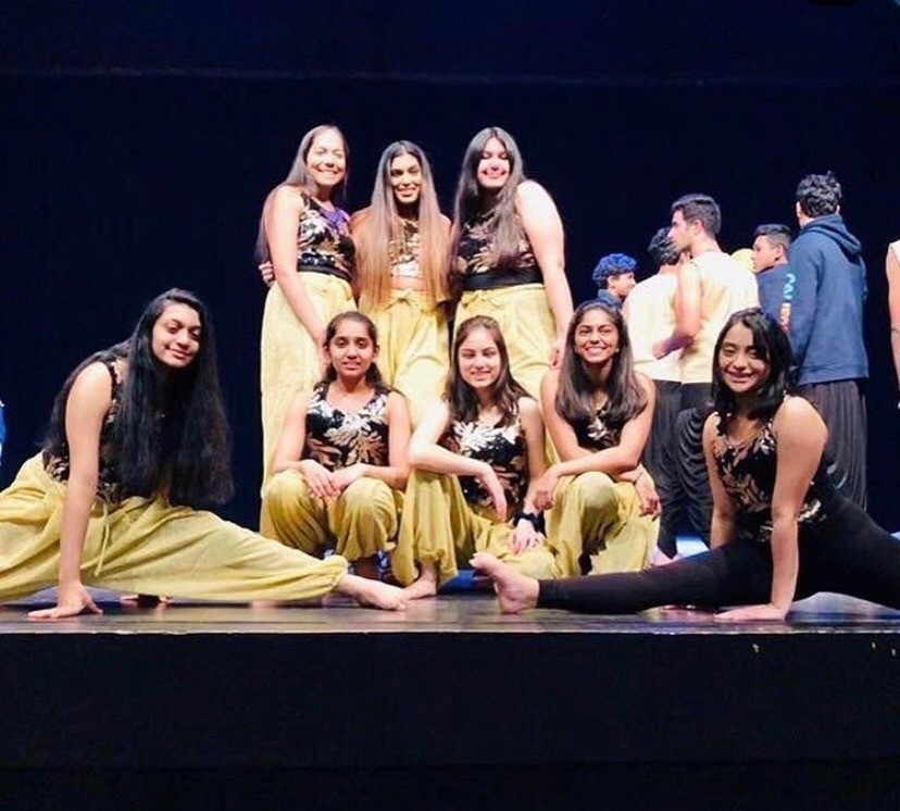 Sophomore Durva Chavarkar(bottom far right) with the rest of the girls in Indian Student Association after the Multi Cultural Show in 2019.