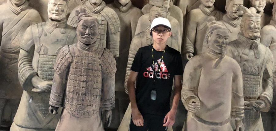 Sophomore Andrew Ma standing amongst some terracotta warriors during a trip to China.