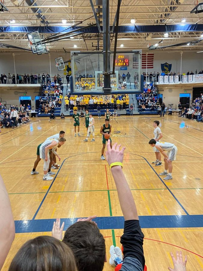 Junior Julian Lewis prepares to shoot a free throw, which would prove to be crucial in the Rats effort to close out Saline in the first round of Districts.