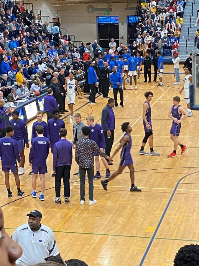 The Pioneers and Railsplitters go through pre-game introductions prior to Round One of district play at Saline High School.