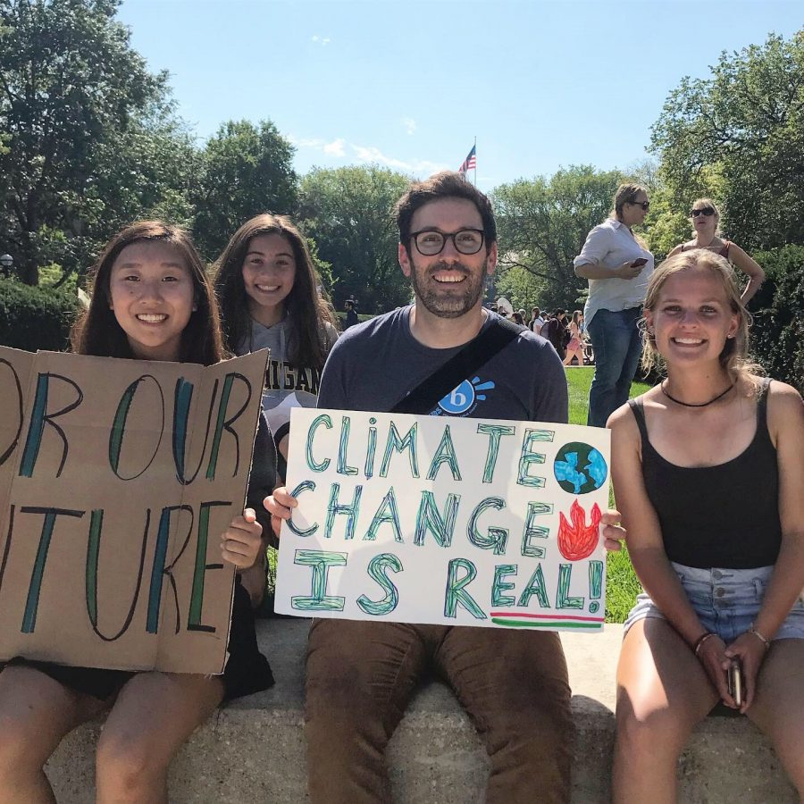 (Left to right) Senior Jasmine Xu, junior Verena Wu, English teacher Mr. Erickson and Junior Rita Seidl protest against climate change in downtown Ann Arbor. Wu often organizes and promotes events like this to the green team and encourages them to participate.