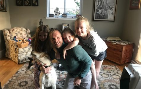 Mr. Schuitman (center) with his daughters and his dog.