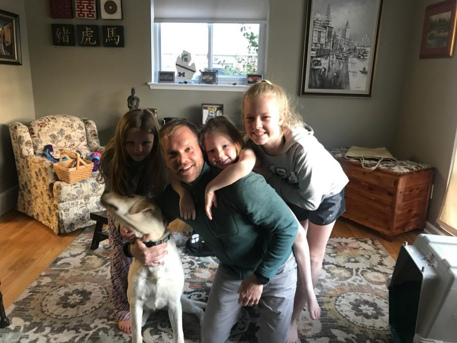 Mr.+Schuitman+%28center%29+with+his+daughters+and+his+dog.