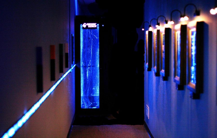 A+lit+blue+pathway+located+at+the+entrance+of+Decode+Detroit.