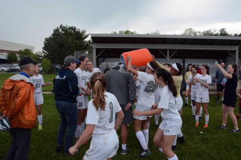 Jadyn Smith showers Coach Lee Hudson with Gatorade shortly after the district final win against Skyline.