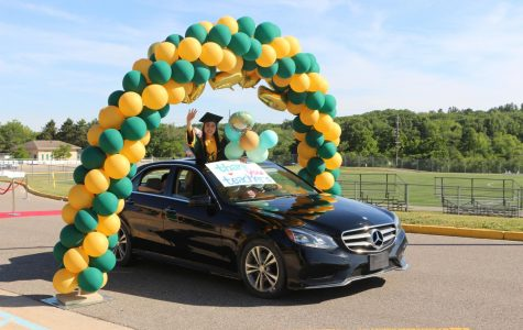 The Emery's 2019-2020 editor-in-chief Julie Heng drives through the balloon arch after passing the red carpet.