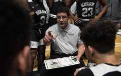 Ann Arbor Huron head coach Waleed Samaha coaches his team between quarters during the game against Ypsilanti Lincoln at the EMU Convocation Center on Tuesday, March 3, 2020.
