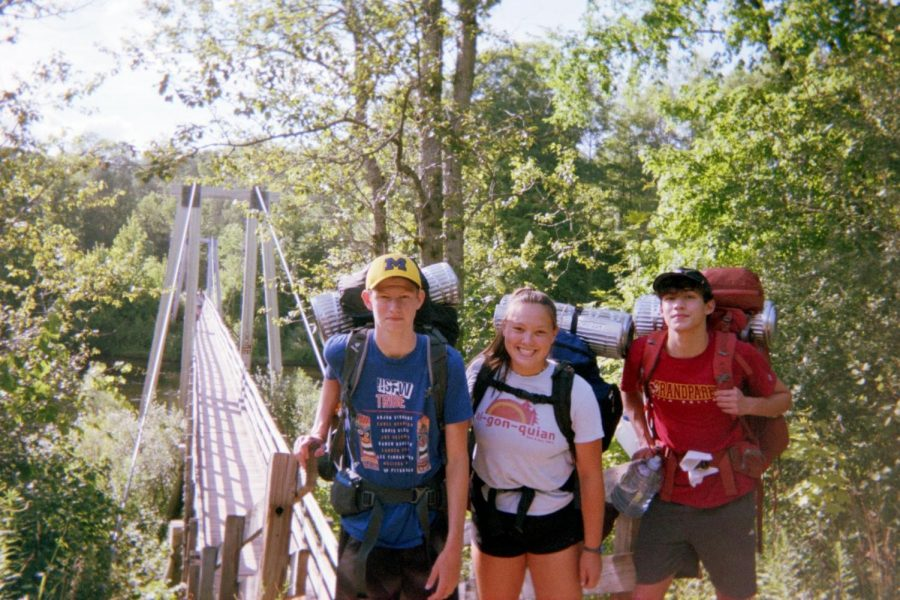 Kate Meader (middle) and her friends on a camping trip.