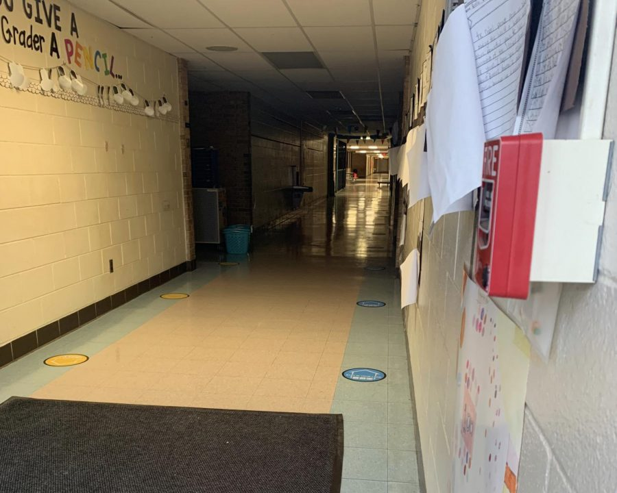 The+halls+of+Logan+Elementary+school+have+been+marked+with+social+distancing+stickers.+This+is+one+of+many+initiatives+pushed+by+Ann+Arbor+Public+Schools+to+work+towards+in-person+schooling.+
