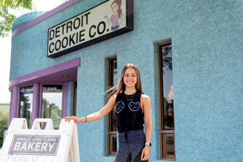 Owner Lauren Roumayah stands in front of the Detroit Cookie Company store in Ferndale. Recently, the second location in Ann Arbor opened.