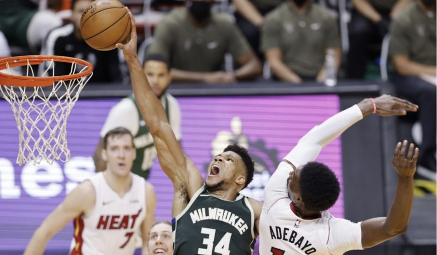 "Giannis ""The Greek Freak"" Antetokounmpo dunks the ball on Heat forward Bam Adebayo."