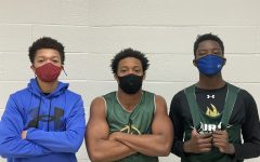 Seniors Devin Womack and Brandon Rawls and junior Jay Wambere wait to enter the gym at Huron High School. The boys play for the River Rat basketball team.