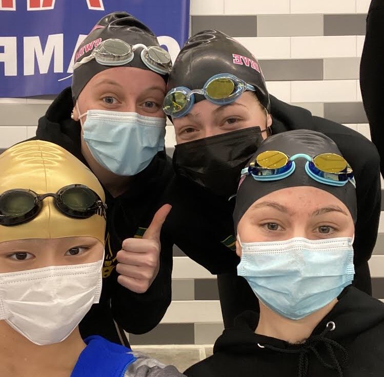 Min Xu, Annaliese Streeter, Kathryn Hemmila, and Zannah Baker pose for a selfie during the women