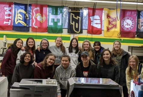 During pre-coronacation, the 2020 members of WISE huddle together for a picture in Hurons engineering laboratory. I loved going to the engineering room after school and doing fun things with other girls that were interested in the same stuff I was, President of WISE Catie Hart said.