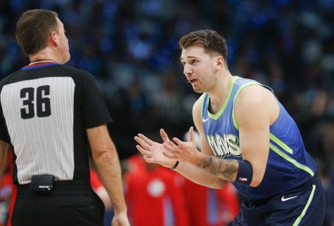 Dallas Mavericks forward Luka Doncic (77) disputes a call by referee David Jones (36) during the first half against the Sacramento Kings on Sunday, Dec. 8, 2019 at American Airlines Center in Dallas, Texas. (Ryan Michalesko/The Dallas Morning News/TNS)