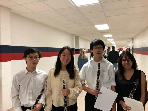 Garrett Jin (second to the right) enjoys playing the clarinet and is part of Huron
