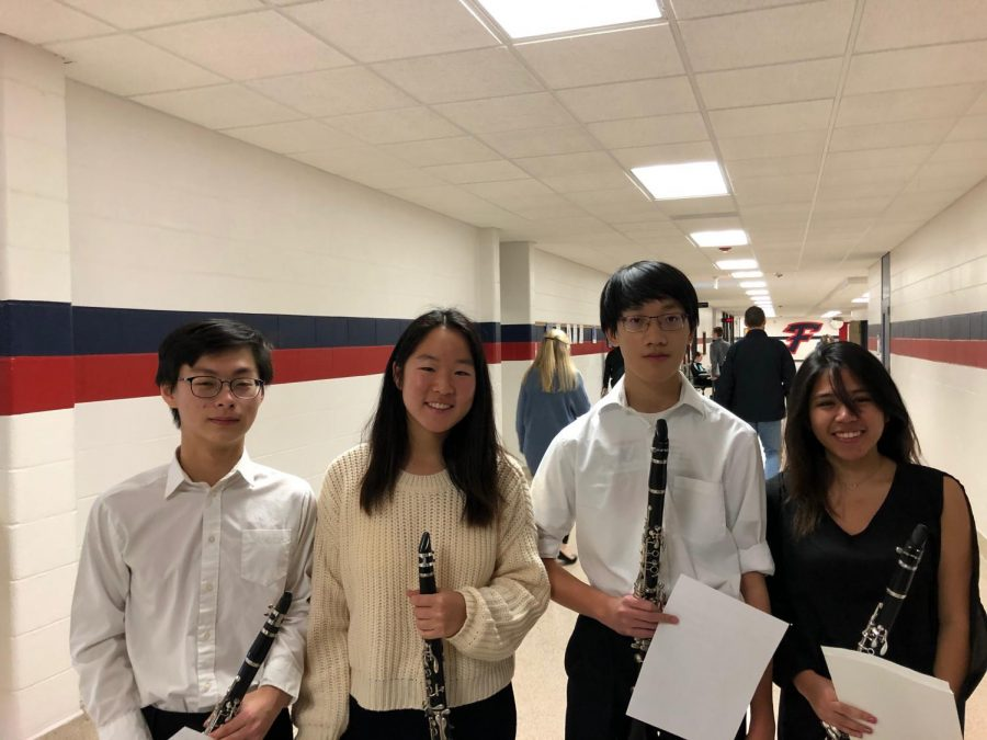 Garrett Jin (second to the right) enjoys playing the clarinet and is part of Huron's symphony band.
