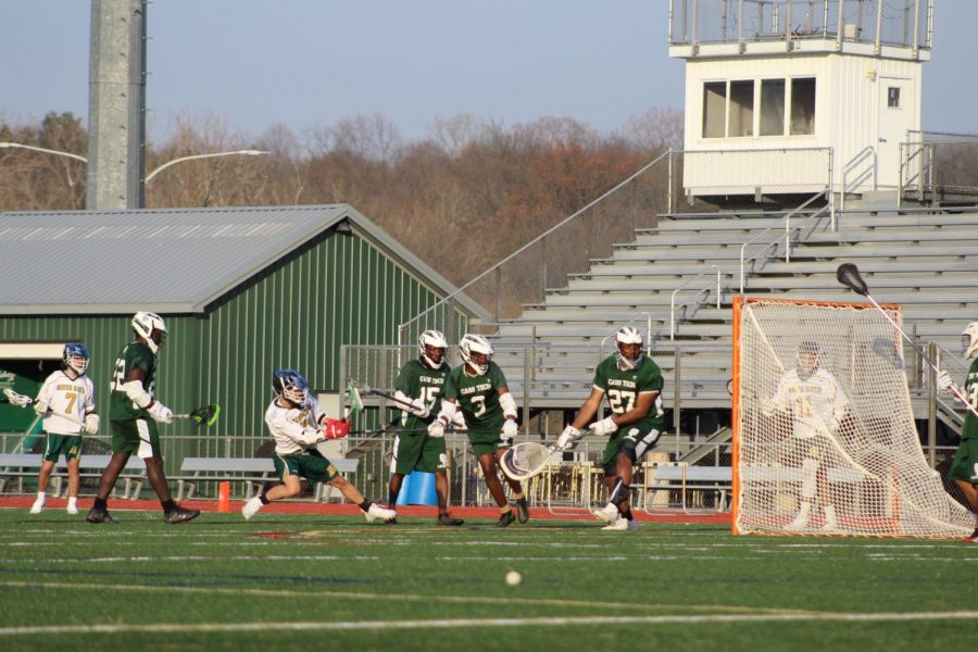 Senior Phuc Pham (#25) scores a quick-shot through the Cass Technical goalie.