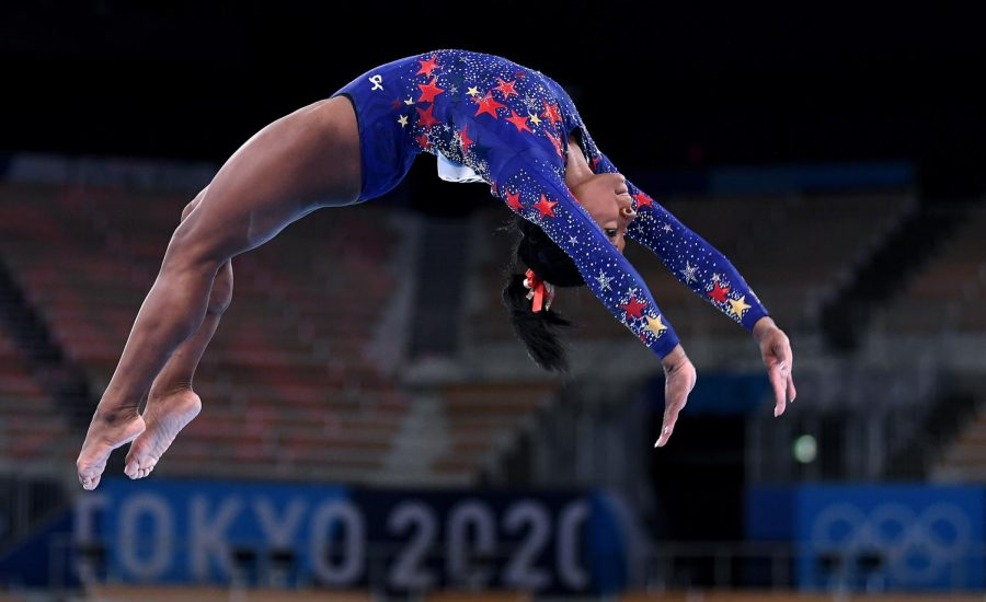 U.S. gymnast Simone Biles competes on the beam in the womens team qualifying at the 2020 Tokyo Olympics on Sunday, July 25, 2021. She withdrew days later, citing her mental health.