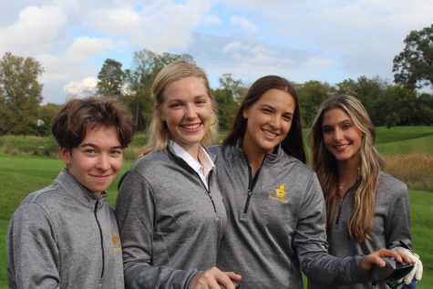 Hurons womens golf team captains (left to right) Varvara Bashkirova, Vicky Underwood, Sasha Lee and Lydia Miteza, pose during the golf teams annual picture day.