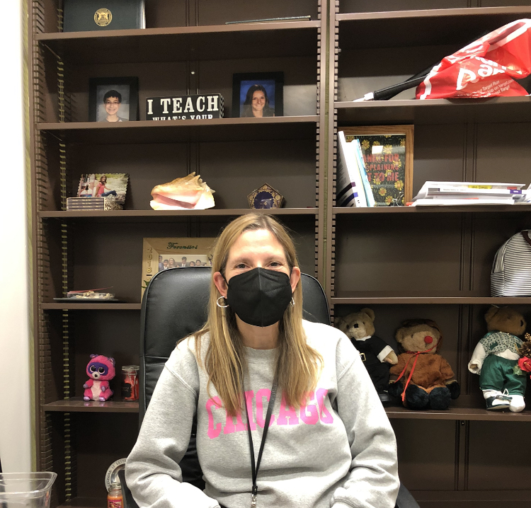 Ms. King-Freyre observes masking policies, while sitting in her office in the English Department.